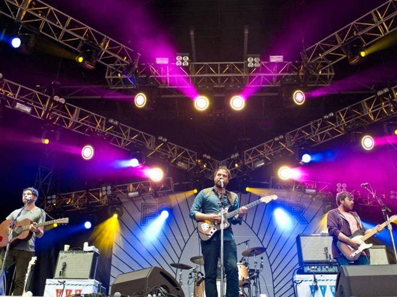 Guitar trio: (from left) Gordon Skene, Scott Hutchison, and Billy Kennedy of Frightened Rabbit on stage this year