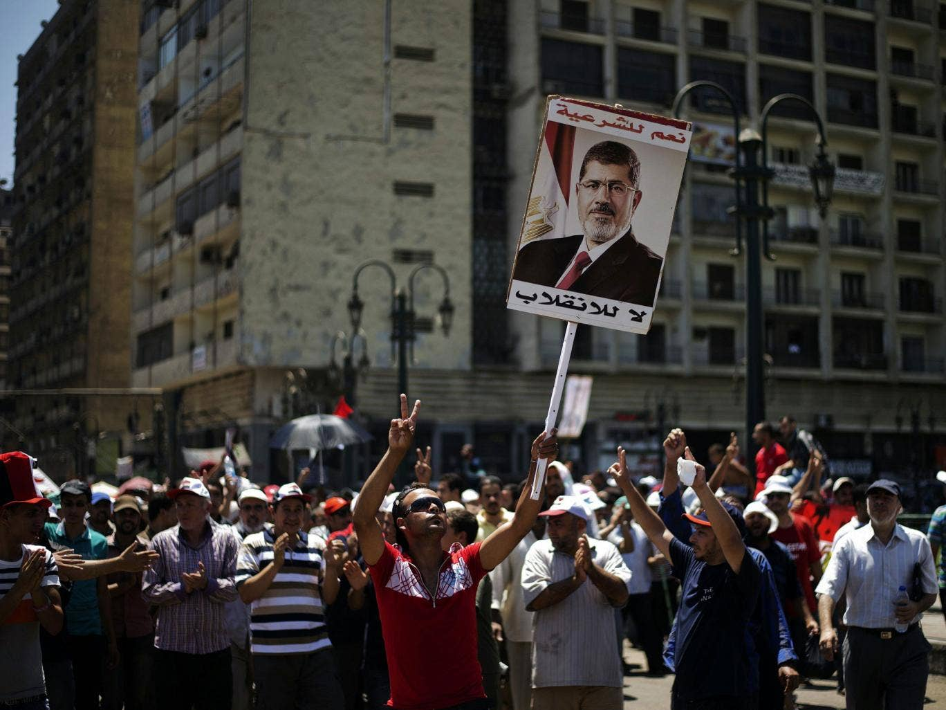 Supporters of the deposed President Mohamed Morsi protest in Cairo yesterday. Rare co-operation between Egypt and Israel saw five suspected Islamic militants killed in the Sinai desert by an Israeli rocket strike