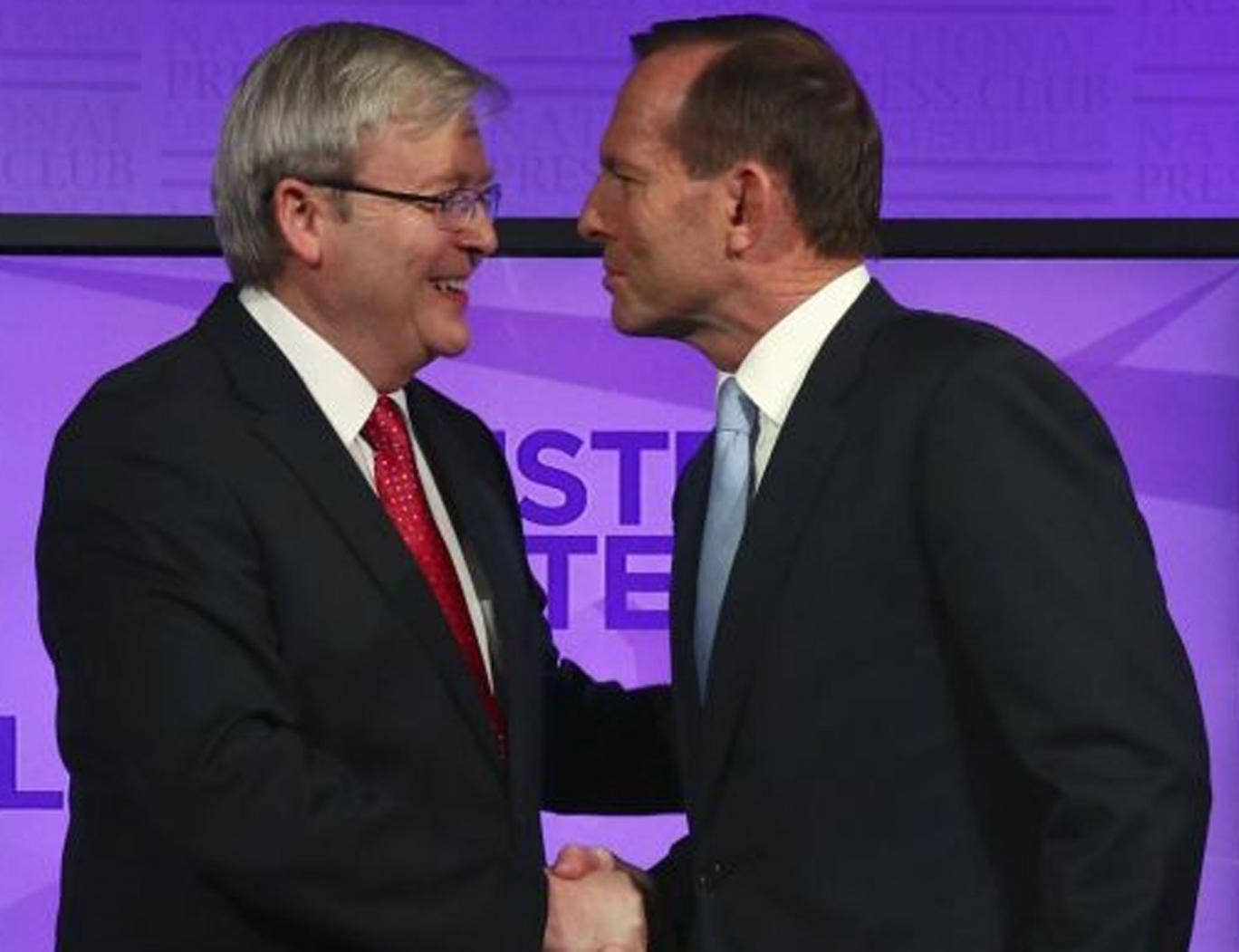 Kevin Rudd (left) and Tony Abbott shake hands before the debate