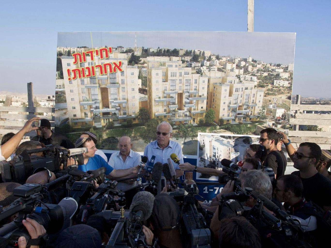 Israel's housing minister, Uri Ariel, talks to press after the announcement of new settlement units
