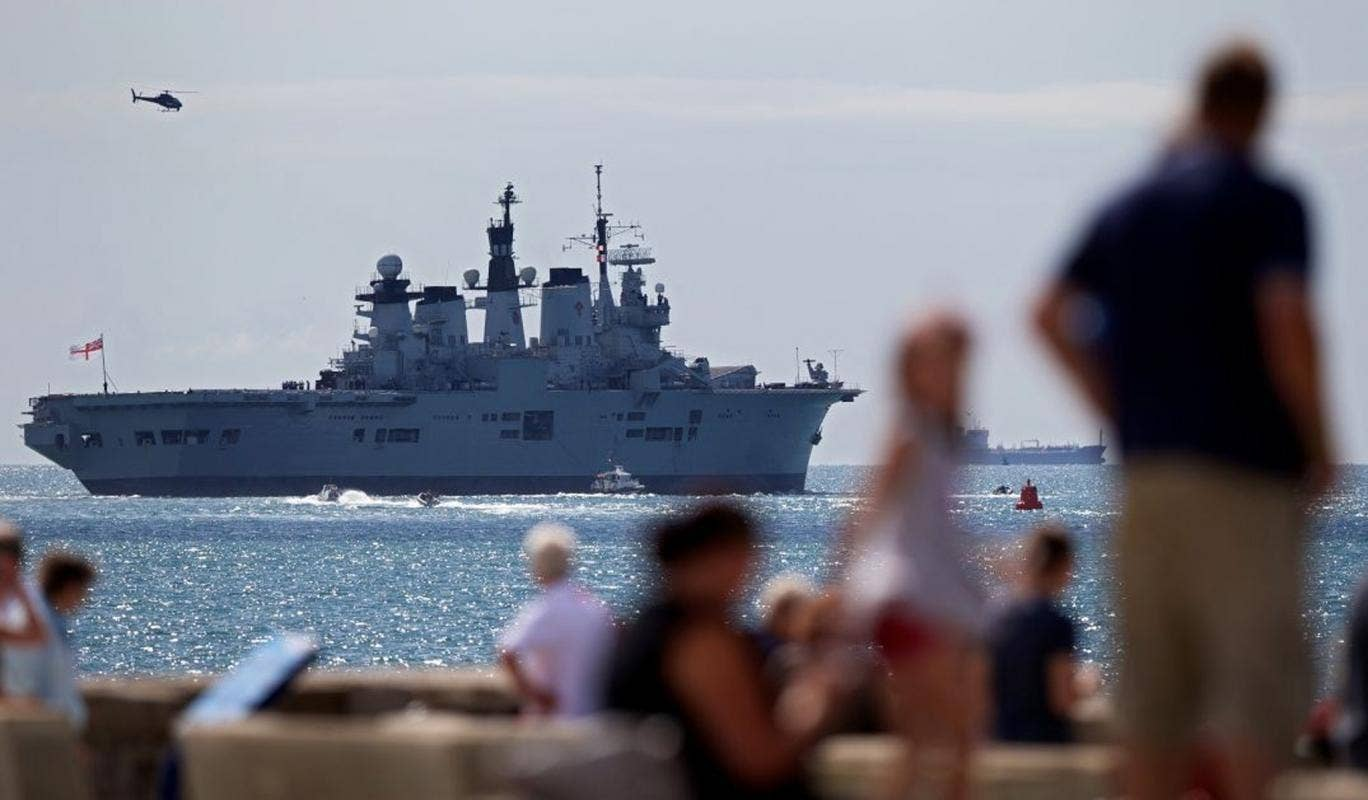 HMS Illustrious leaves Portsmouth navy base as British warships began setting sail for the Mediterranean for a naval exercise that will see one vessel dock in Gibraltar, as tensions rise with Spain over the British-held territory