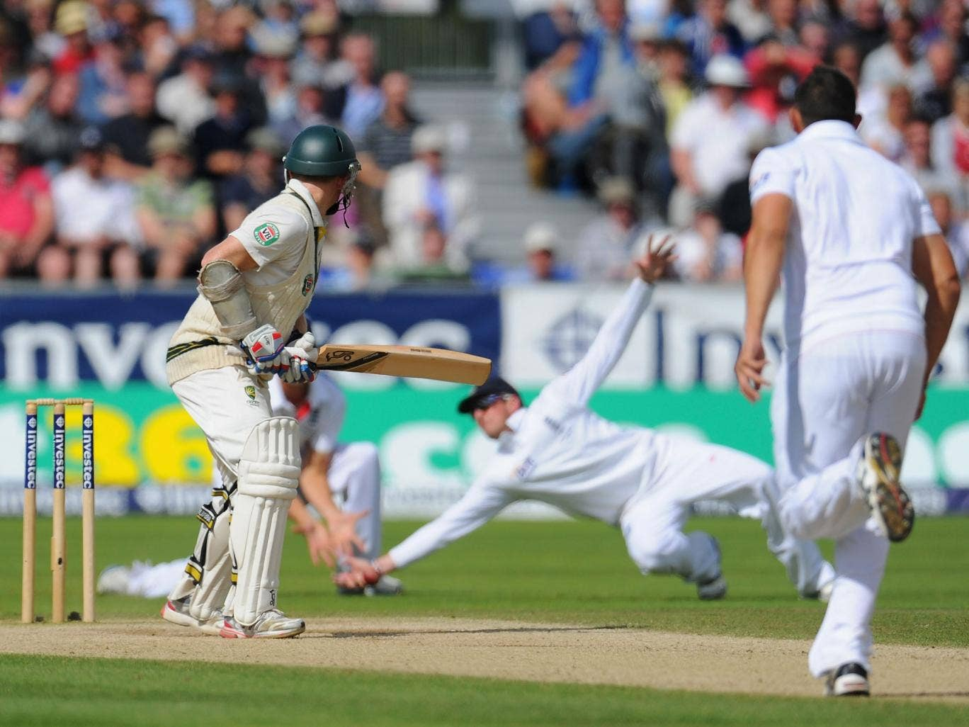 Chris Rogers is dropped at slip by Graeme Swann