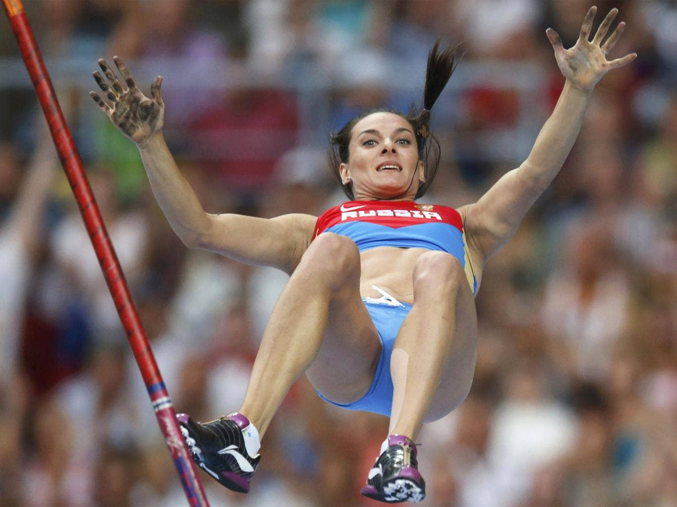 Yelena Isinbayeva claims victory in the pole vault final