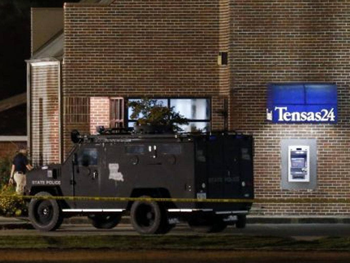 A SWAT vehicle outside the Tensas State Bank in St. Joseph as investigators work throughout the early morning hours