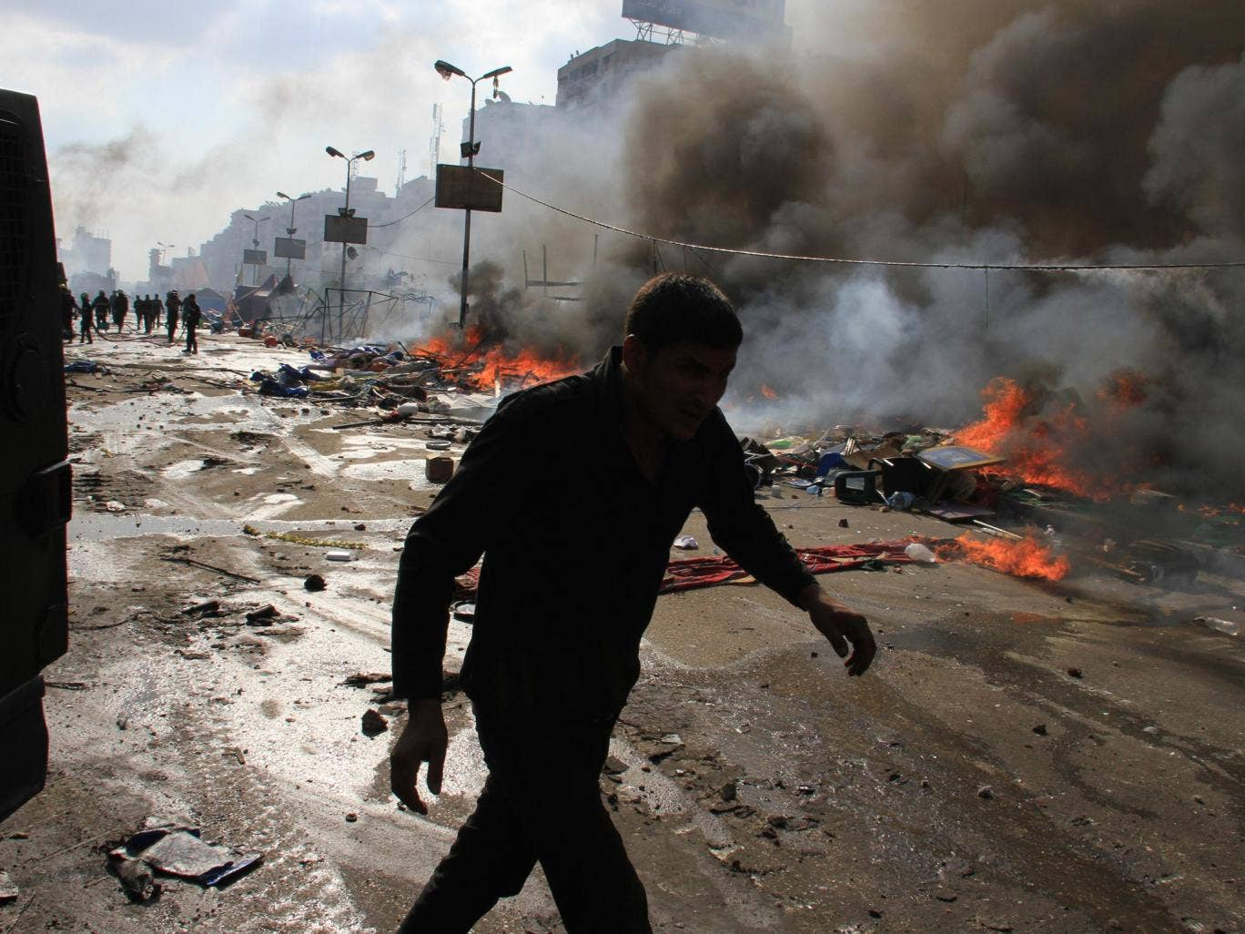 Egyptian security forces clear a sit-in by supporters of ousted Islamist President Mohammed Morsi in the eastern Nasr City district of Cairo