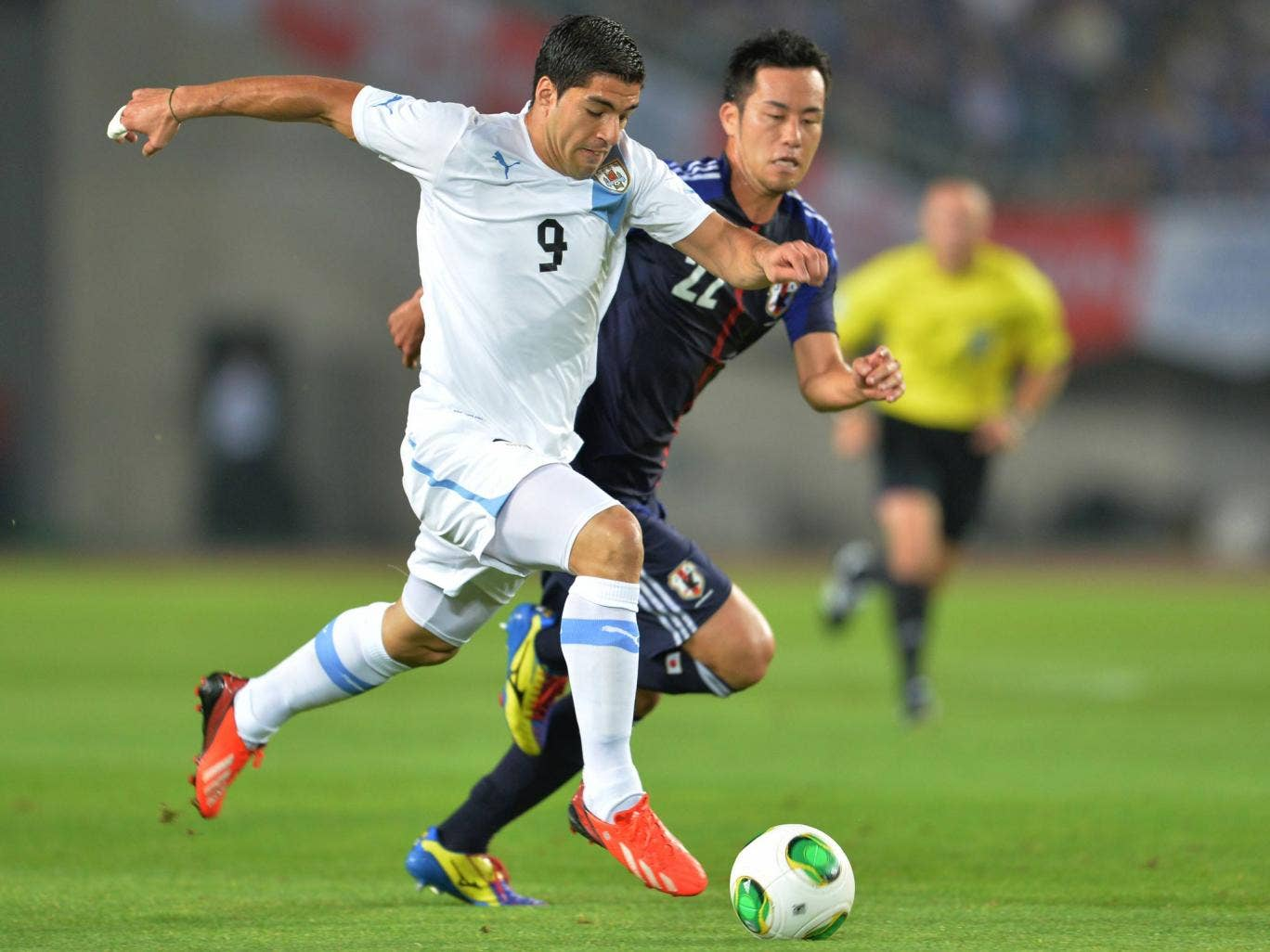 Luis Suarez in action for Uruguay against Japan