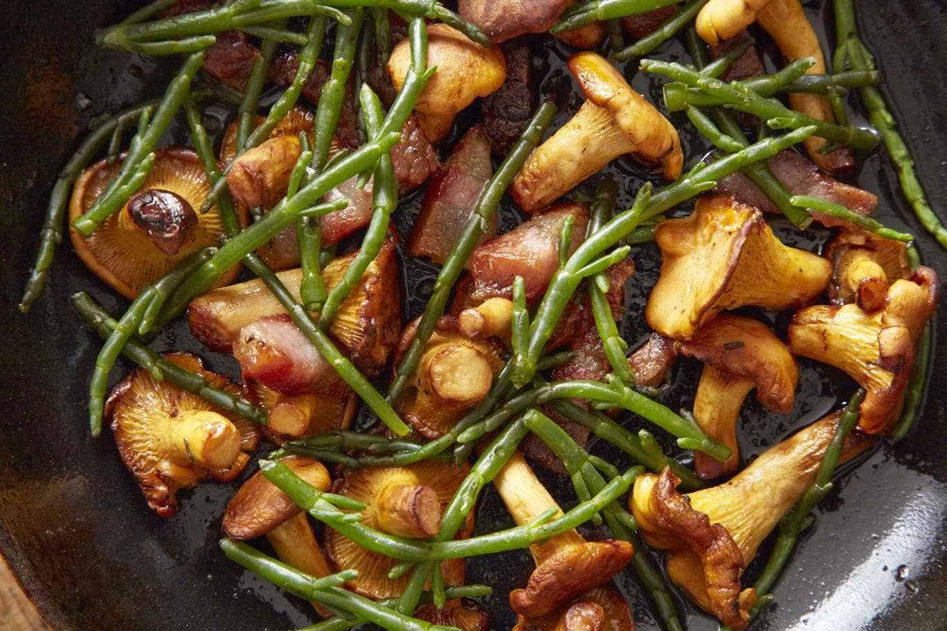 A plate of girolles, samphire and bacon