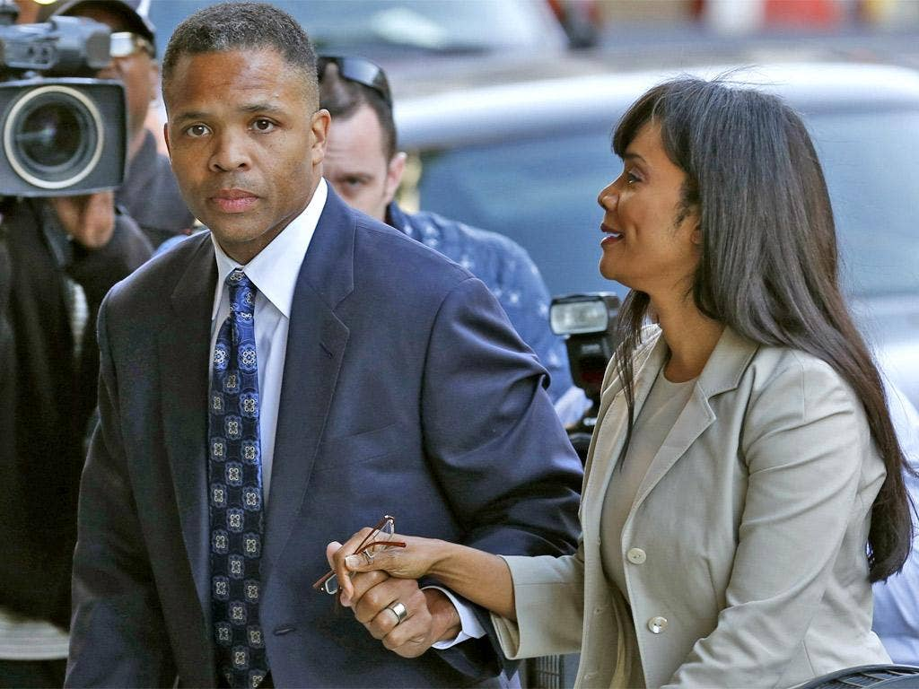 Jesse Jackson Jr and his wife Sandi arrive in court