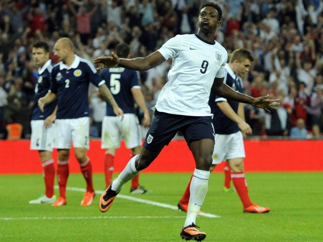 Danny Welbeck takes the applause after heading in England's second goal