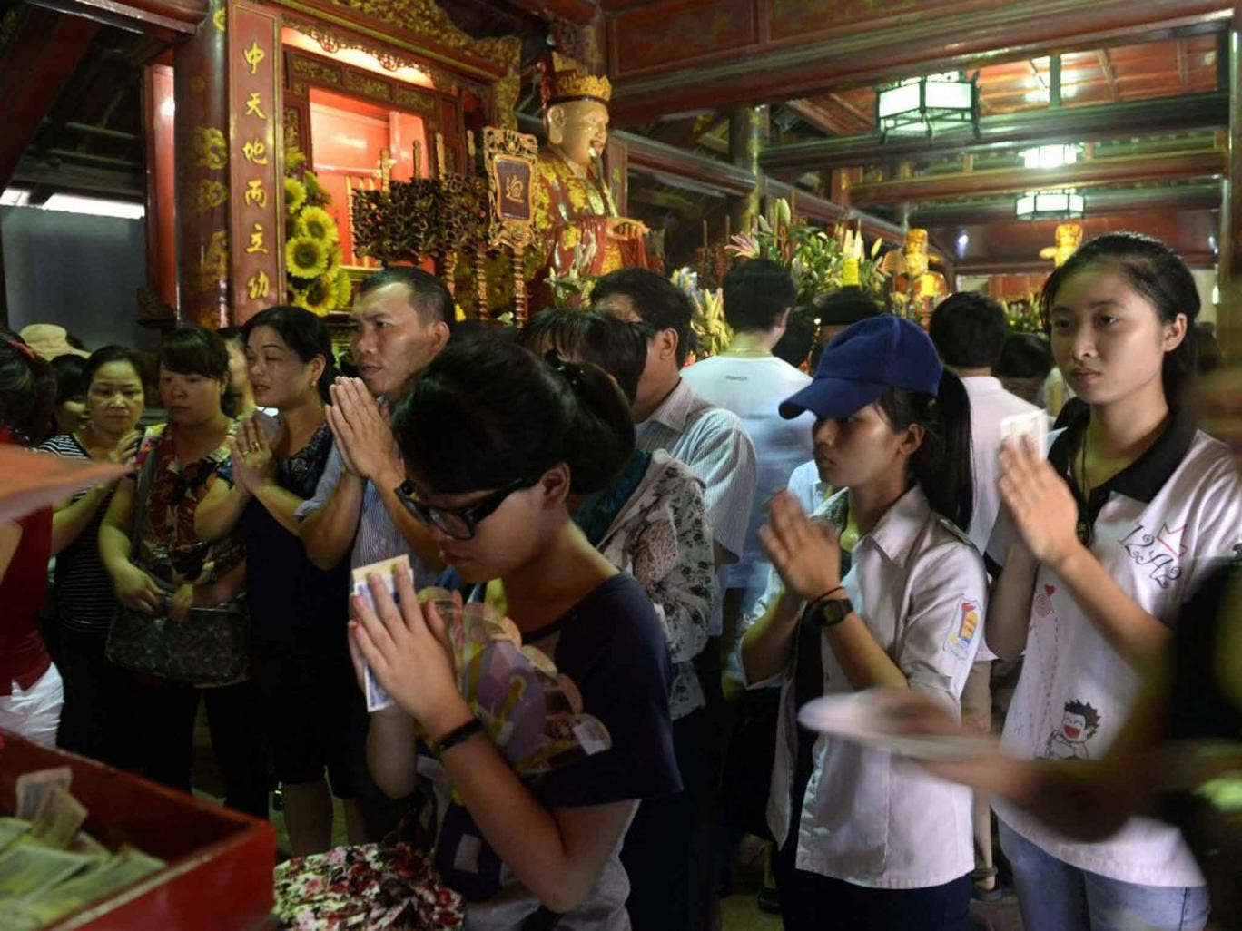 Students praying for luck before exams at a Vietnam university