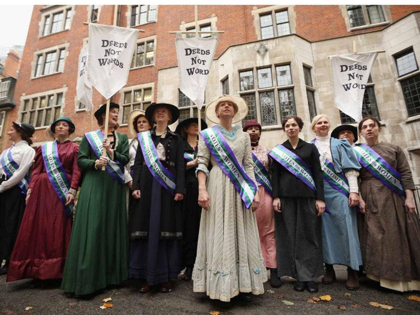 Hear their roar: campaigners dressed as suffragettes attend a rally organised by UK Feminista