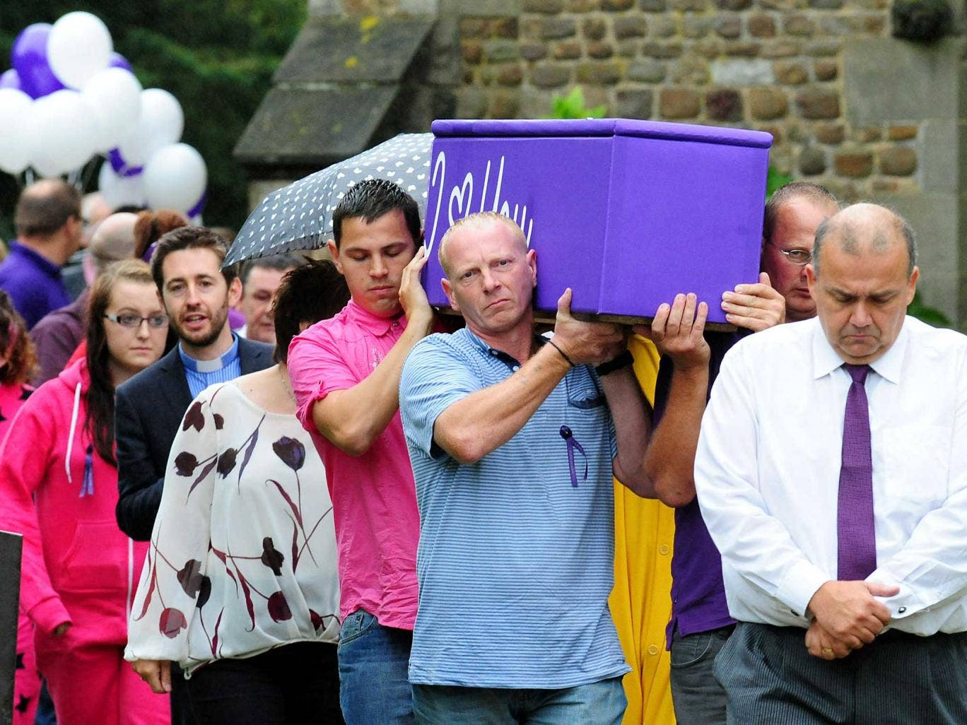 Hannah Smith's father David  Smith (centre) carries her coffin following the teenager's funeral service