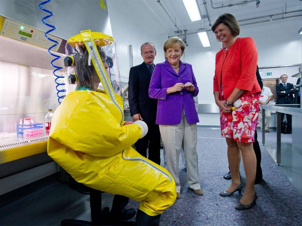 Chancellor Merkel visits a veterinary research facility in Riems