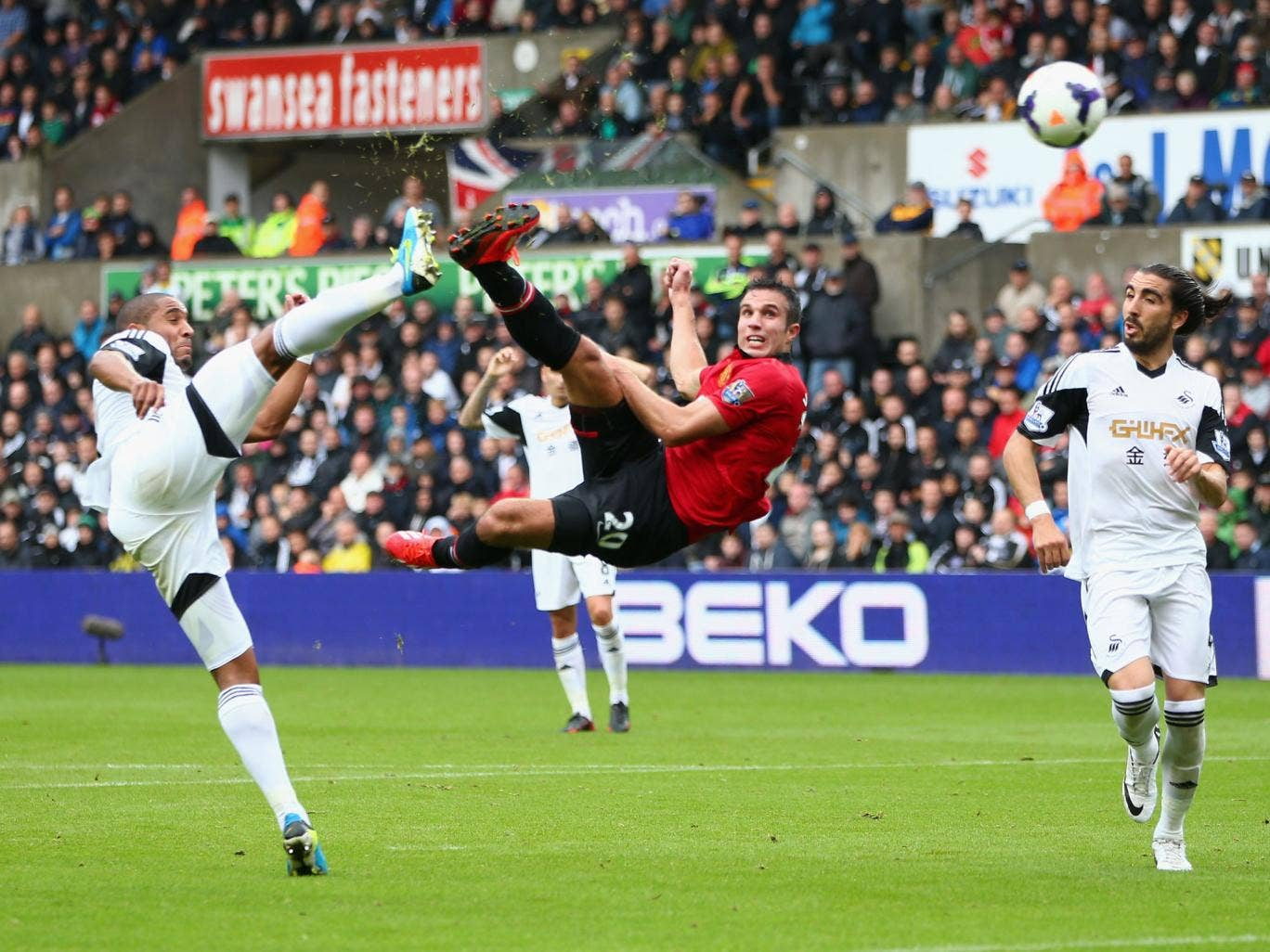 Robin van Persie puts Manchester United ahead with an acrobatic effort in the champions' win