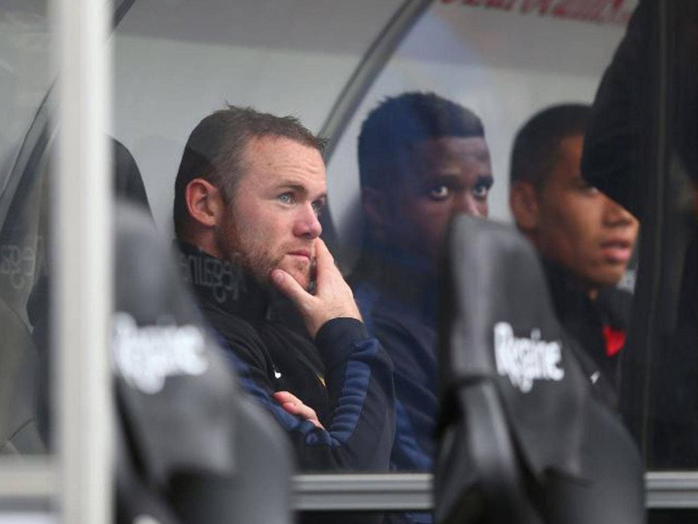 Wayne Rooney came off the bench to assist Manchester United's third and four goals - although his body language did not suggest contentment (Michael Steele/Getty Images)