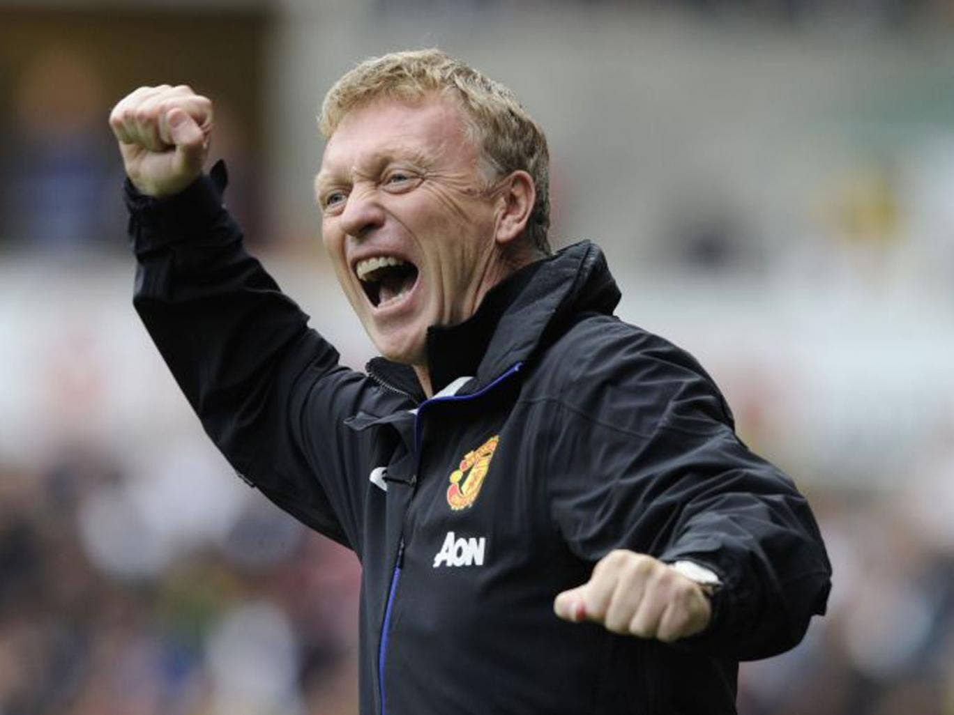 Moyes celebrates one of Manchester United goals during his first league game in charge of the club (Rebecca Naden/Reuters)