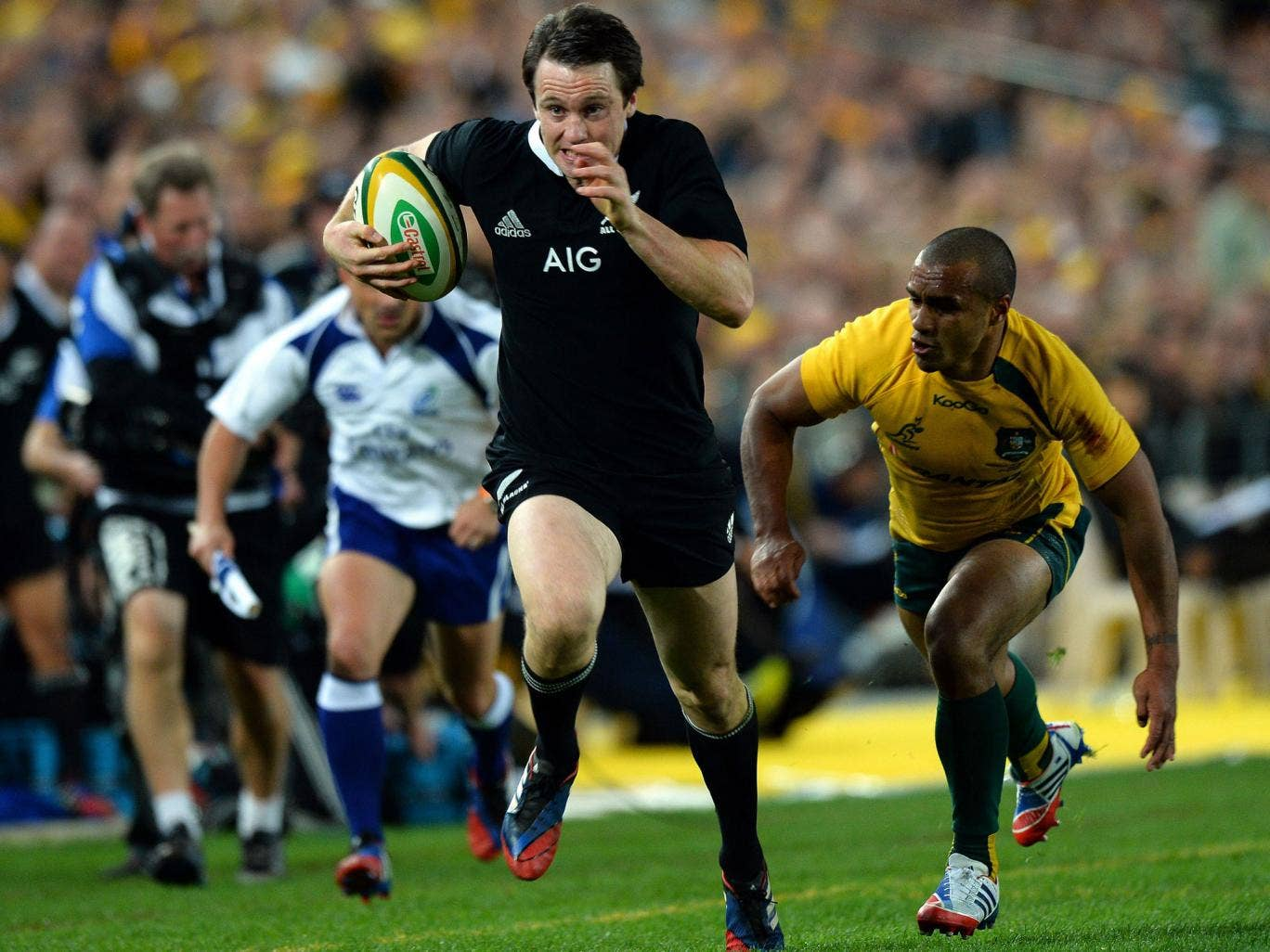 Quick step: Ben Smith evades Australia's Will Genia before running in one his three tries for New Zealand in their 47-29 win in Sydney