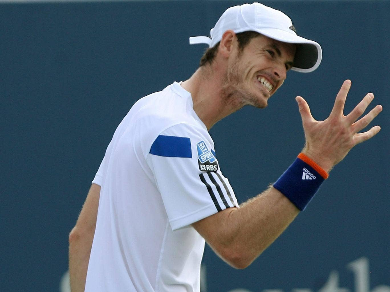 Off hand: A frustrated Andy Murray during his defeat to Tomas Berdych