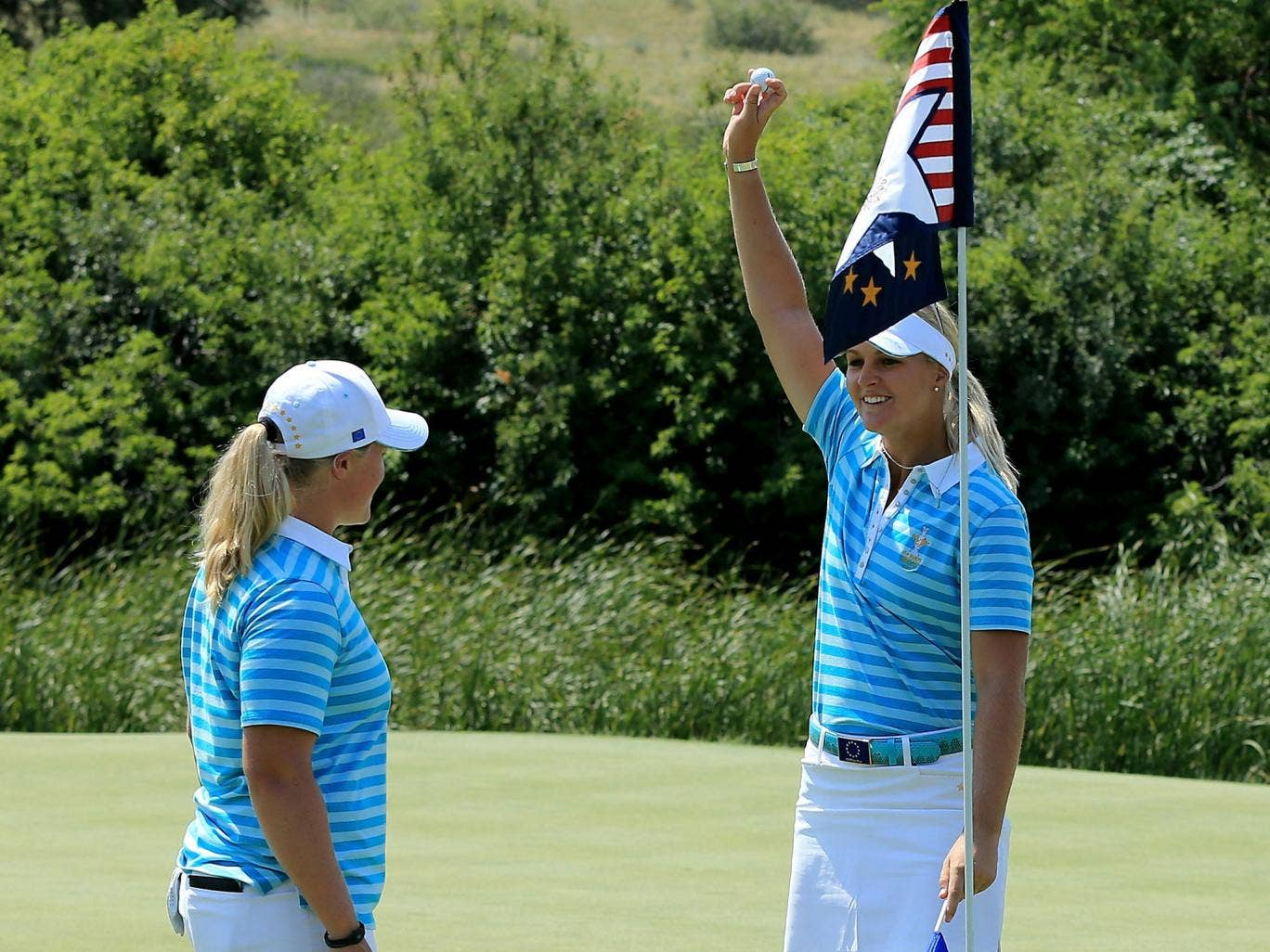 That's ace: Anna Nordqvist, right, celebrates her hole-in-one with Caroline Hedwall, left