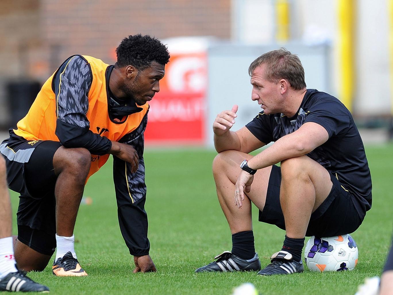 Brendan Rodgers talks with Daniel Sturridge