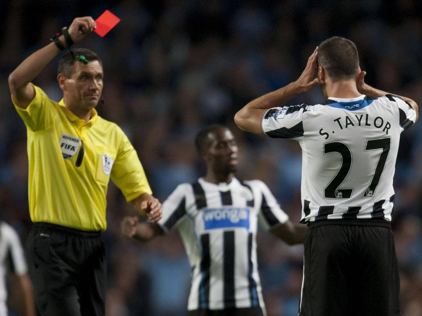 Newcastle's Steven Taylor is shown a straight red card last night
