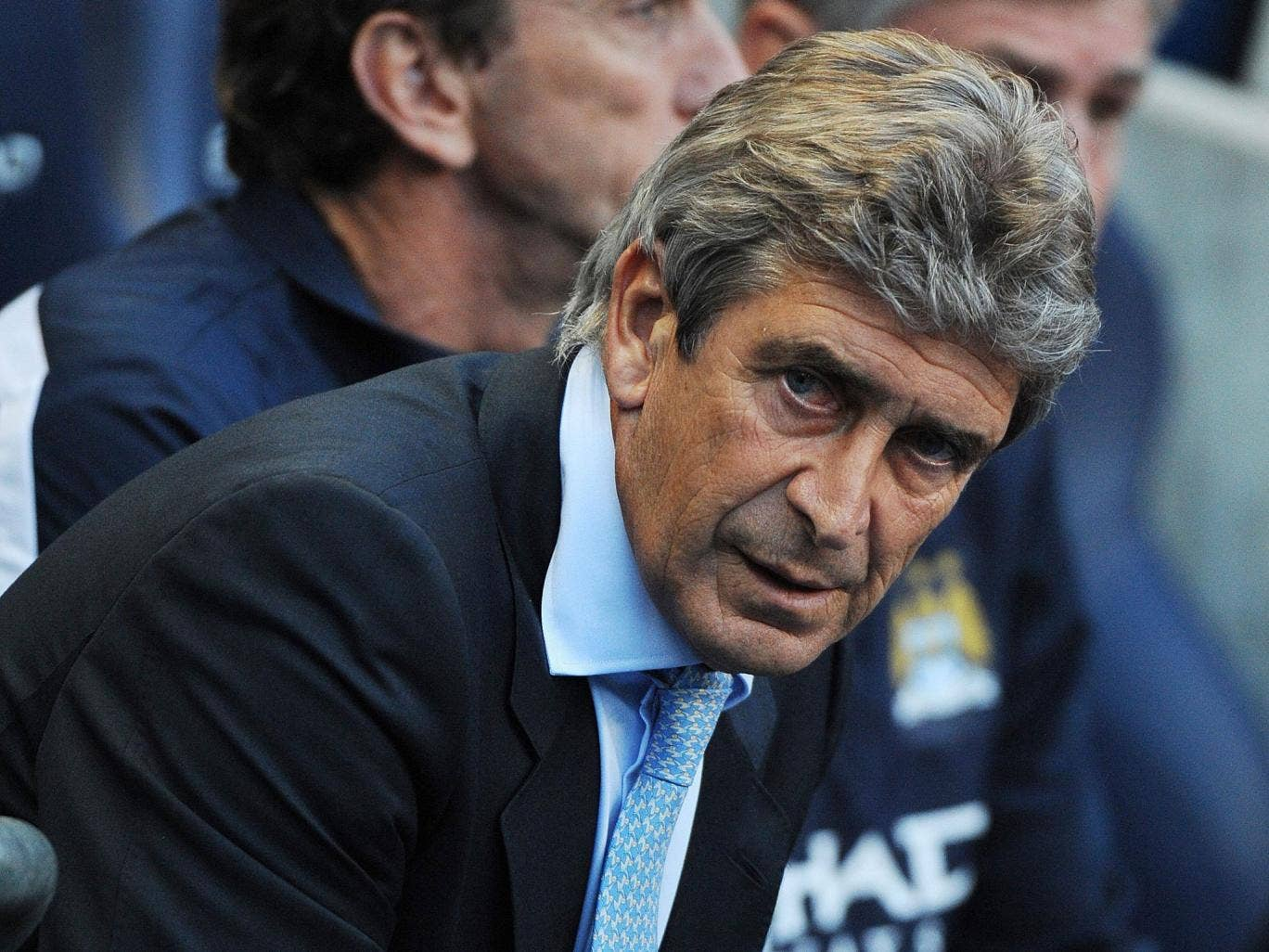 City manager Manuel Pellegrini looks on with satisfaction