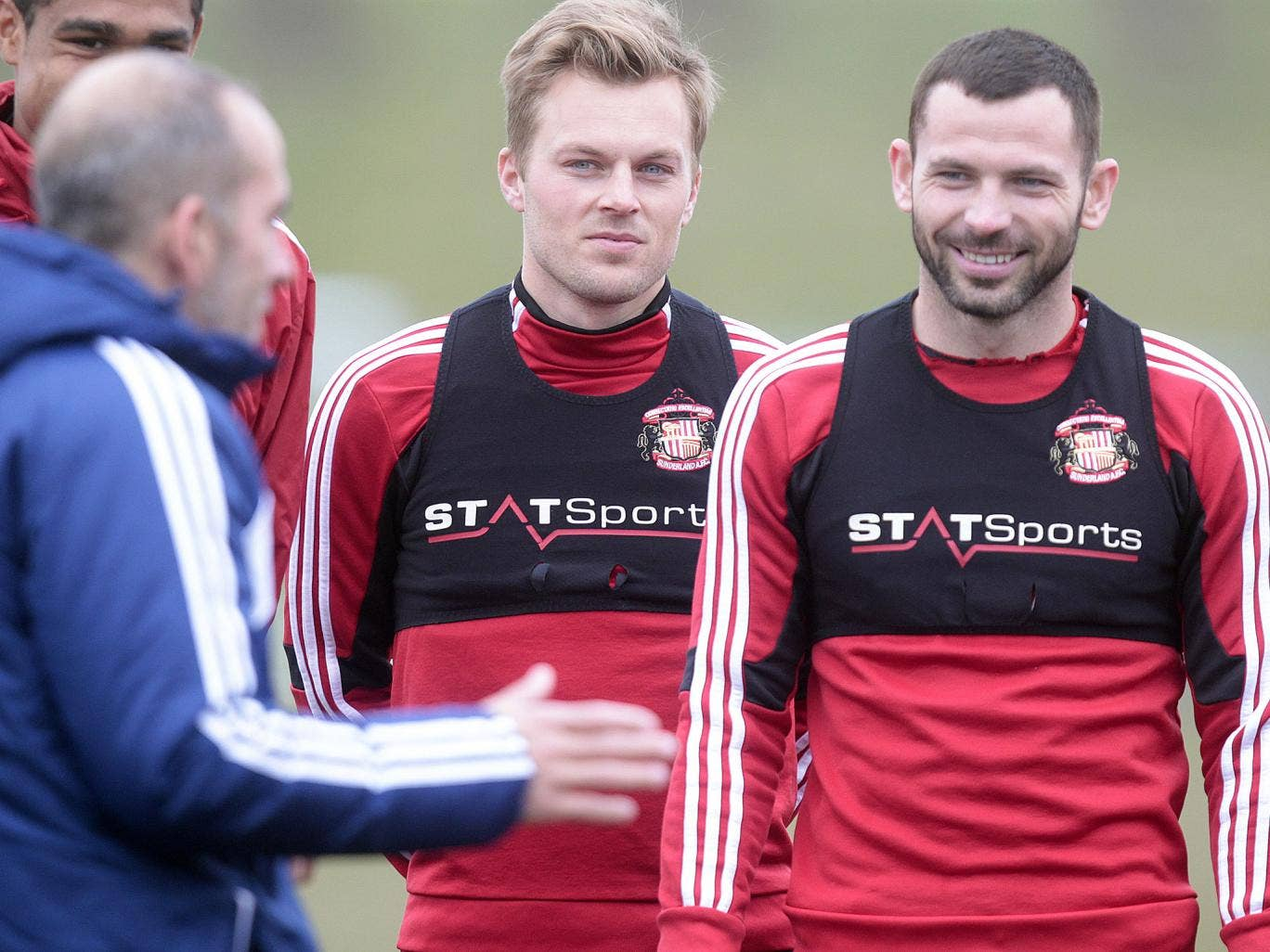 Phil Bardsley alongside Sebastian Larsson as they listen to Sunderland boss Paolo Di Canio