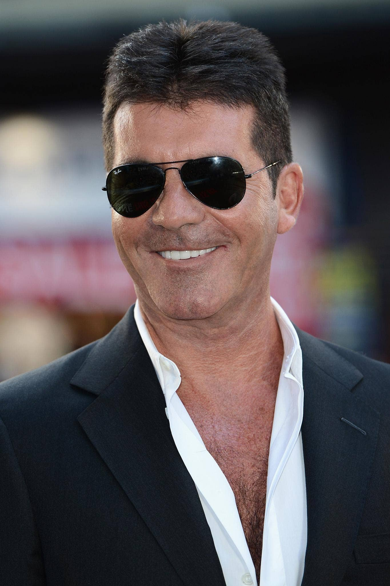 Simon Cowell says he is 'proud' to be becoming a father