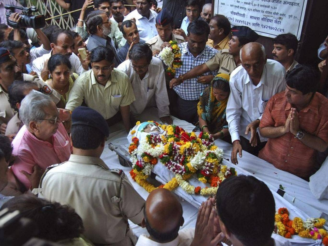 Narendra Dabholkar received threats for his work against mysticism and spirituality. Mourners pay last respects to the anti-superstition activist who was killed in Pune