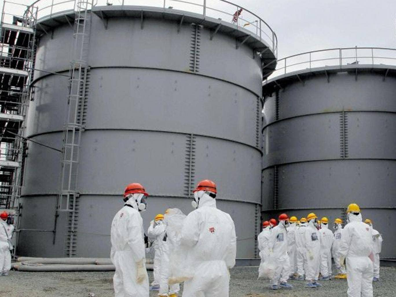 The decision to raise threat level at nuclear plant is seen as another sign that engineers are losing control over the leaks