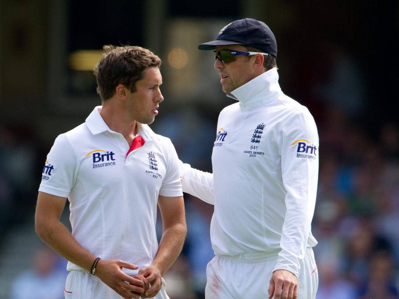 A shell-shocked Simon Kerrigan is comforted by England's senior spin bowler Graeme Swann