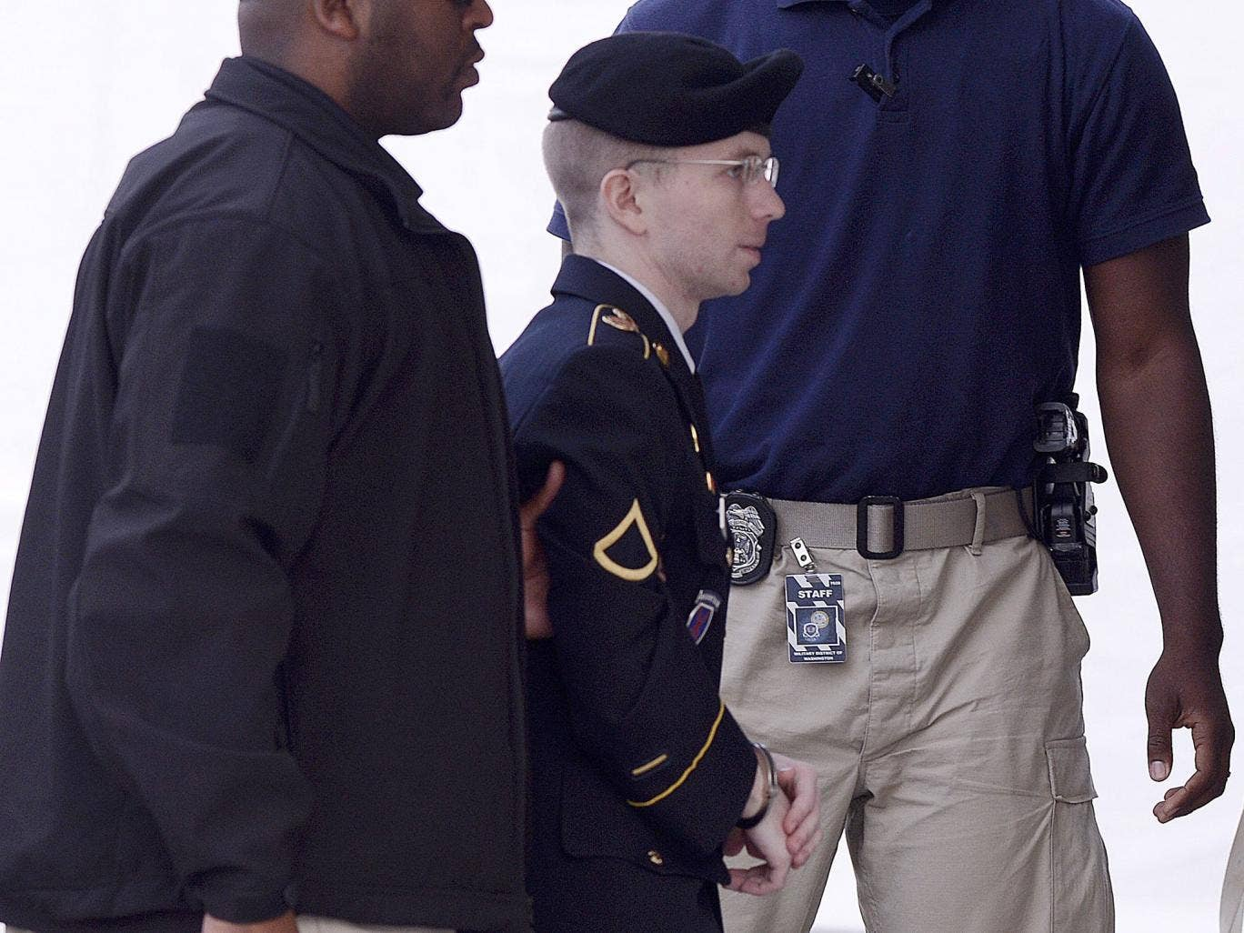 Bradley Manning is escorted into the courthouse