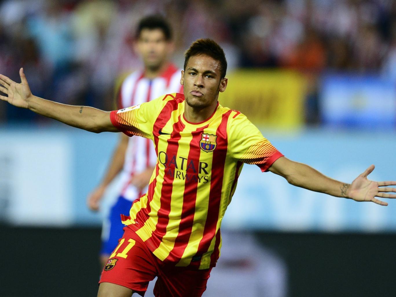 Neymar celebrates his first goal for Barcelona
