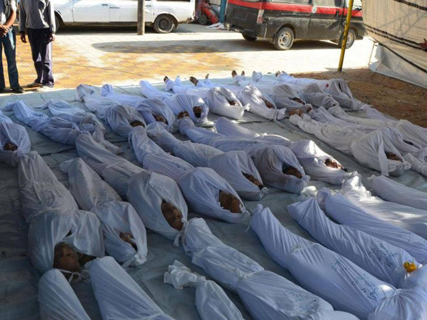 Victims of the Ghouta attack lie in a makeshift morgue