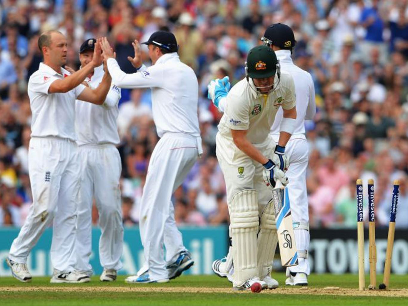 Jonathan Trott, far left, is congratulated after taking the wicket of Australia's Brad Haddin