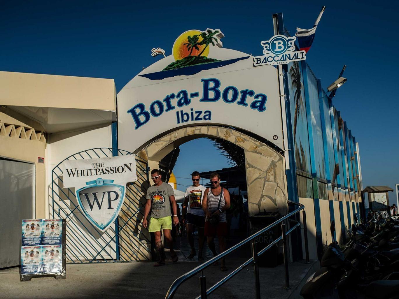 Tourists leave the Bora-Bora Bar at  Playa d'en Bossa