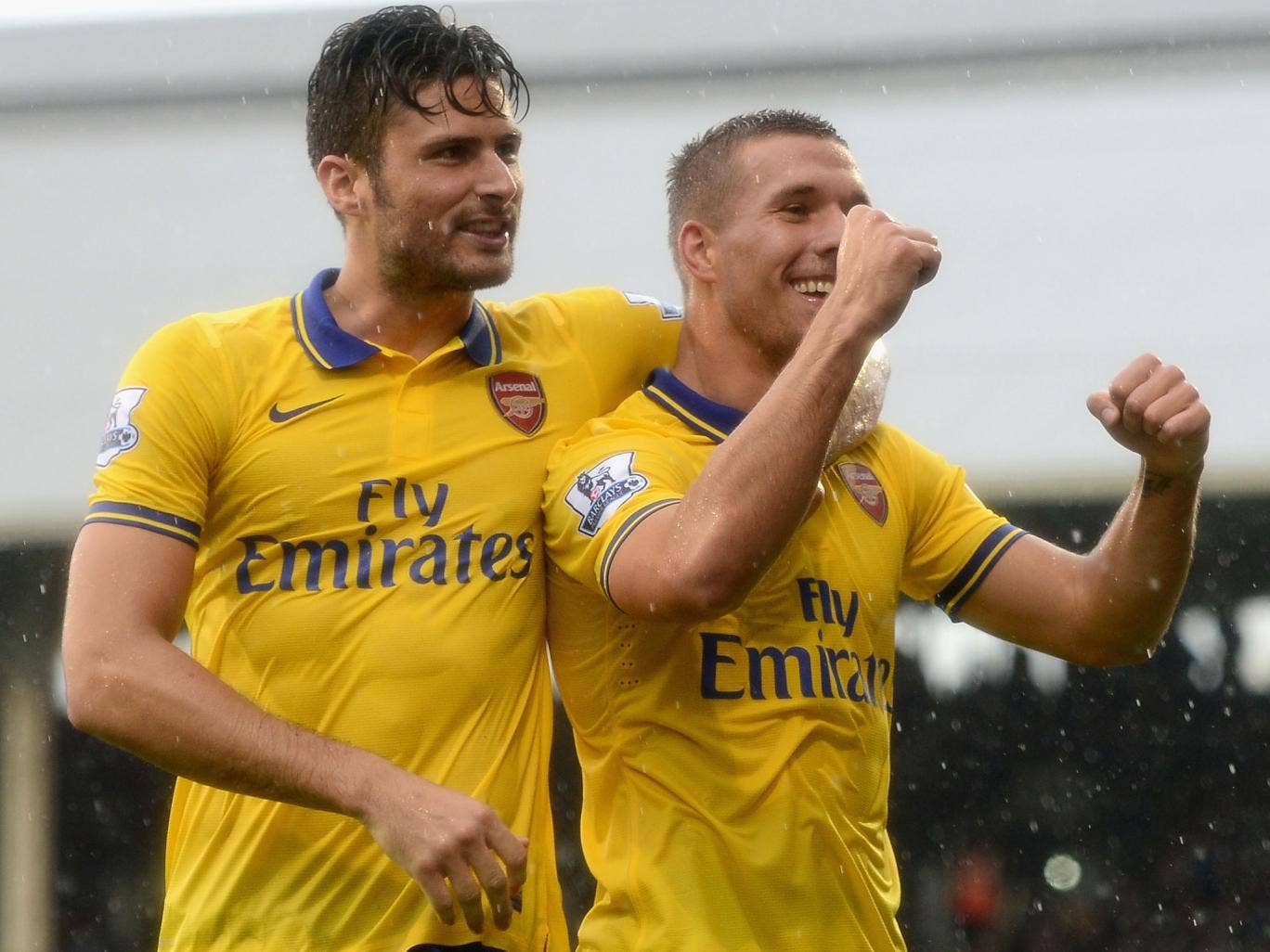 Lukas Podolski celebrates his second goal of the game with Olivier Giroud