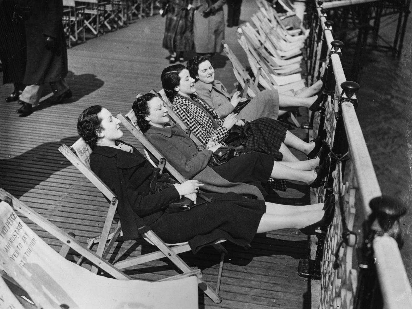 Feet up: Taking the air on a Brighton pier in 1937