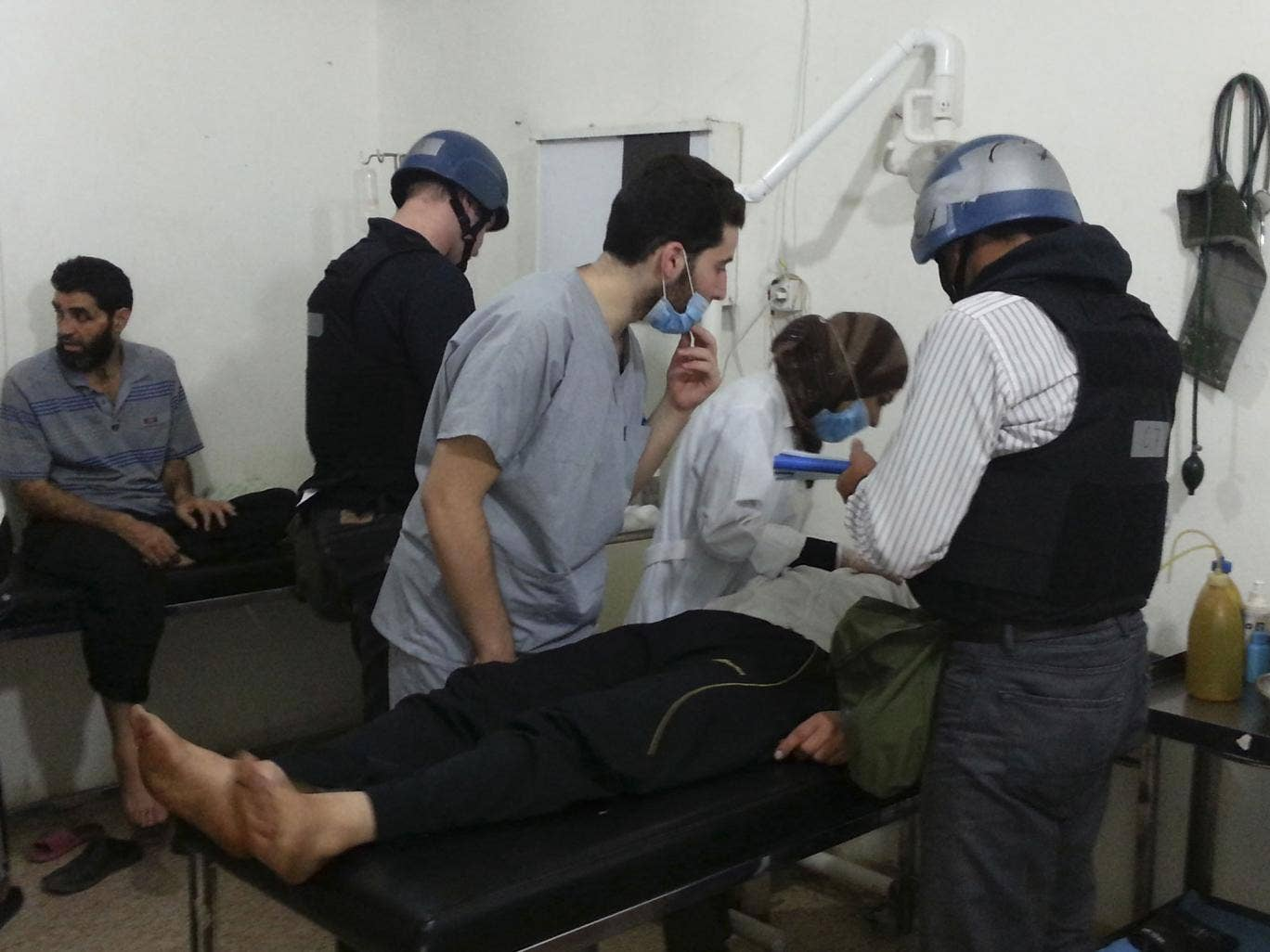 U.N. chemical weapons experts visit people affected by an apparent gas attack