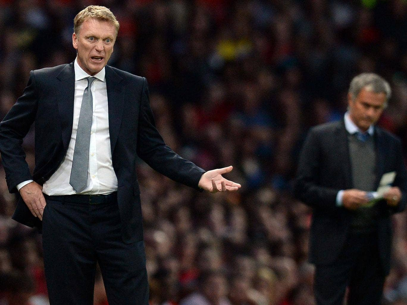 David Moyes (left) prowls the technical area last night as Jose Mourinho takes notes