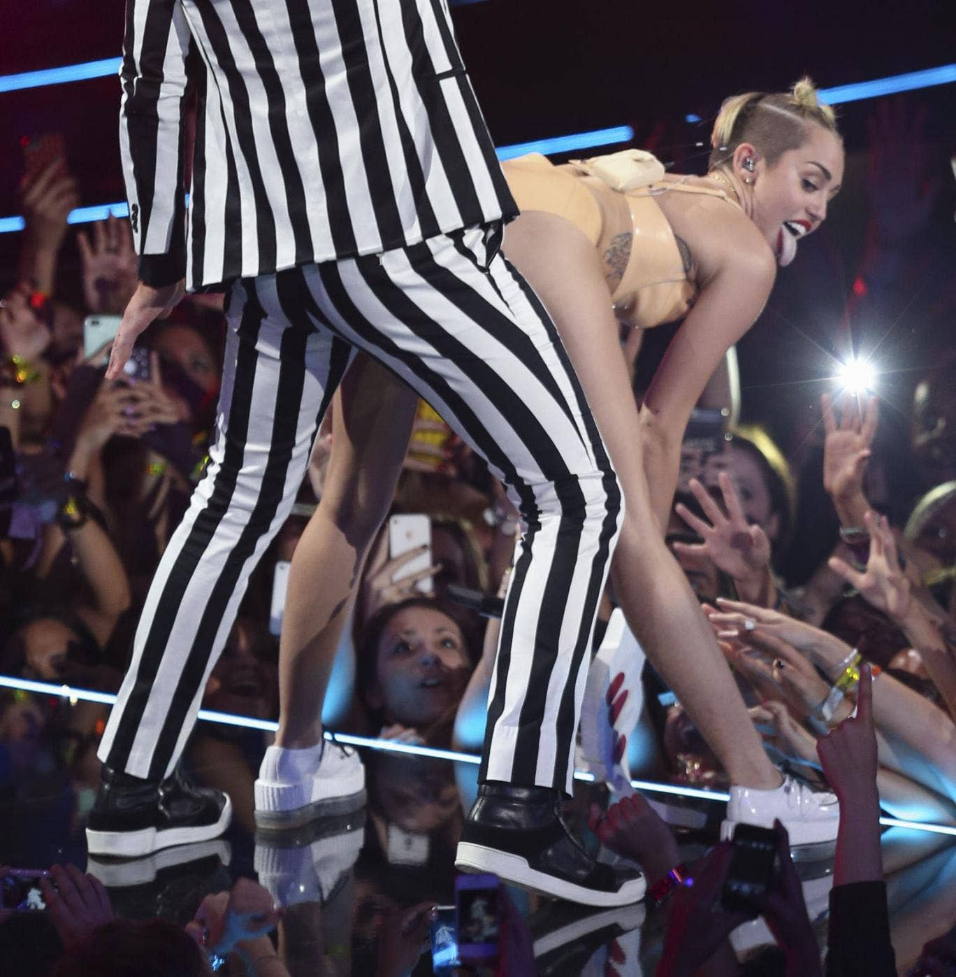 Blurred Lines? Miley Cyrus twerks during her performance with Robin Thicke at the VMAs.