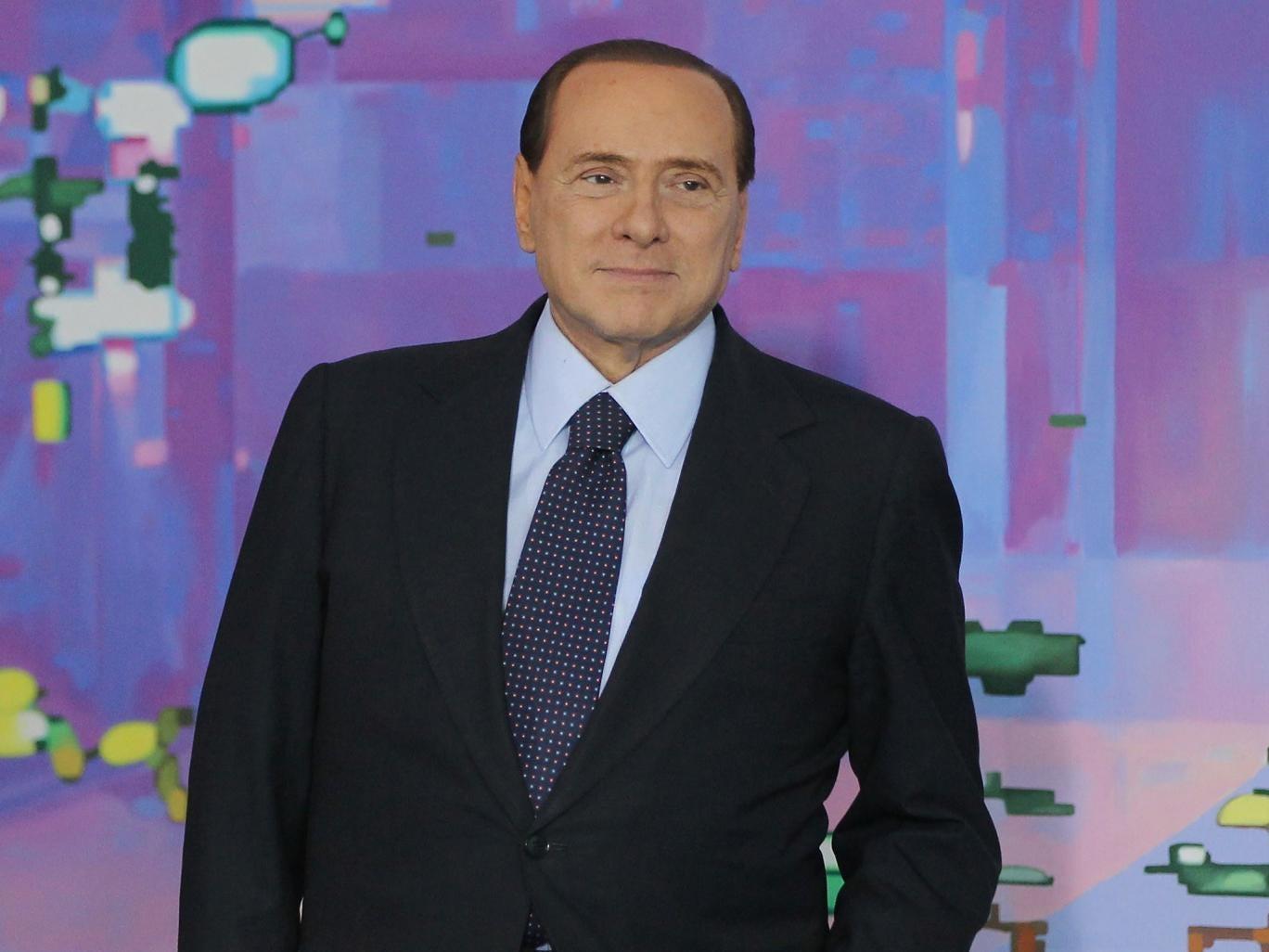 The former Italian premier, Silvio Berlusconi, has called off his political attack dogs