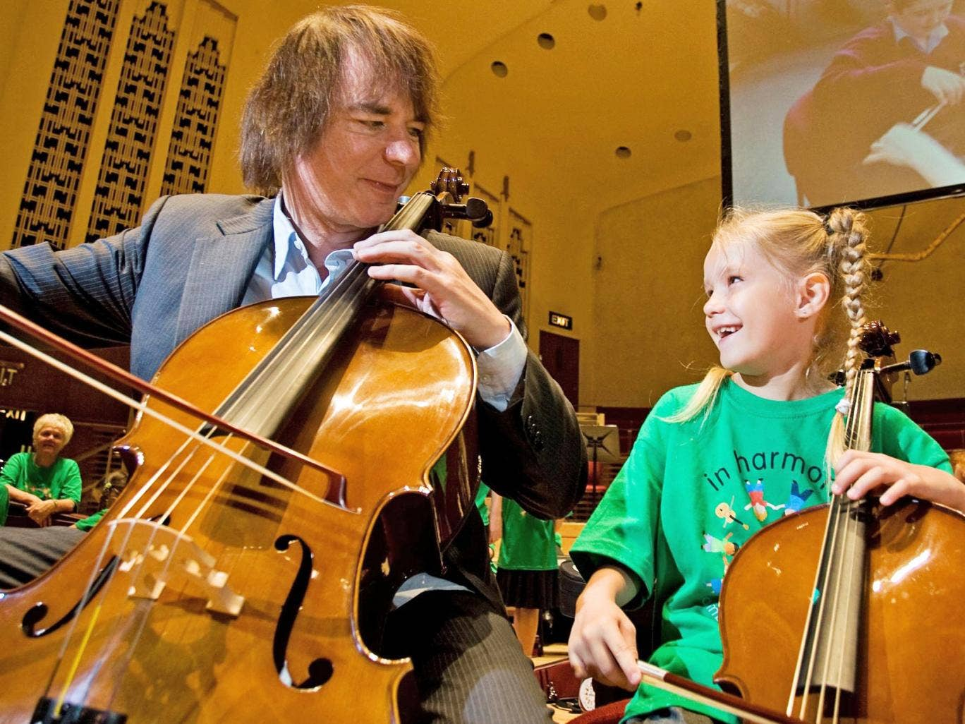Take a bow: Julian Lloyd Webber plays with six-year-old Lauren Russell, a member of In Harmony