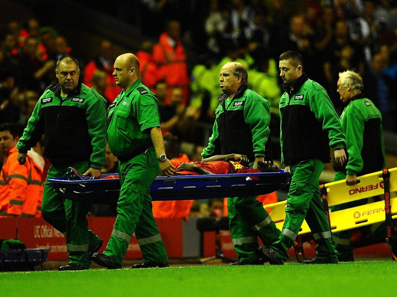 Kolo Toure of Liverpool is stretchered off during the Capital One Cup Second Round between Liverpool and Notts County at Anfield