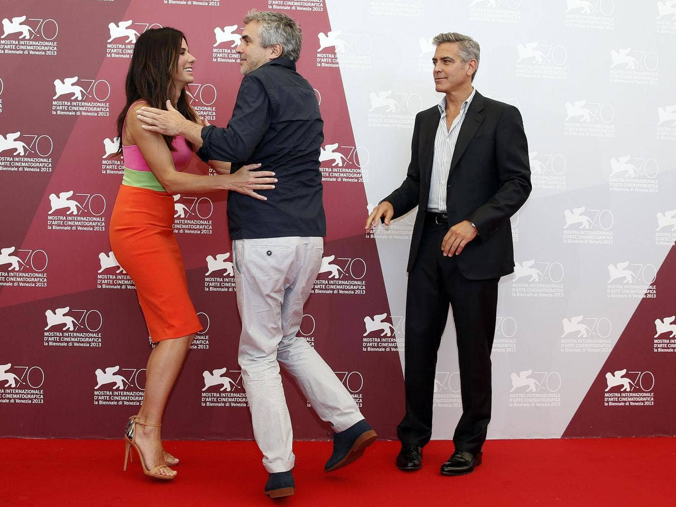 George Clooney, Sandra Bullock and director Alfonso Cuaron arrive at the 70th Venice Film Festival in Venice