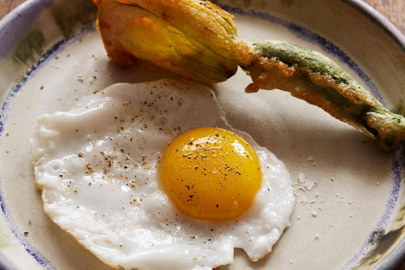 Fried duck's egg with courgette flowers