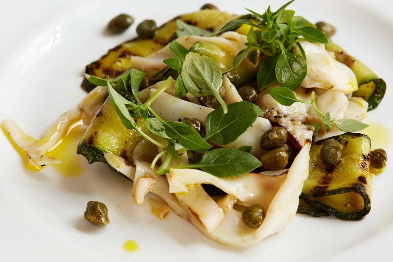 Grilled courgettes with cuttlefish and capers