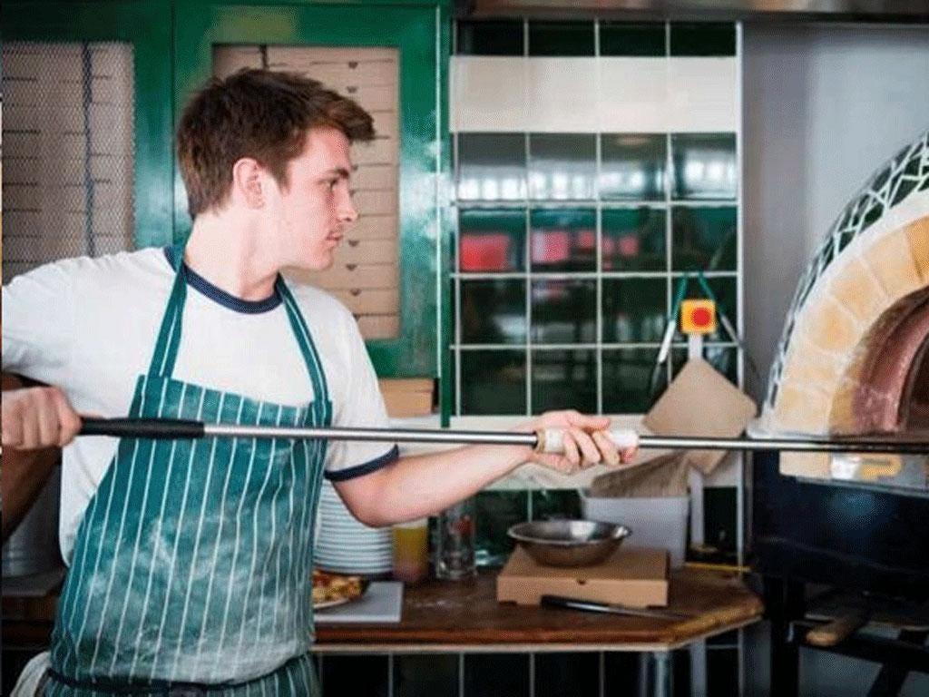 James Elliot converted Plaggio Ape van into a mobile pizza oven - bringing Napoli to London
