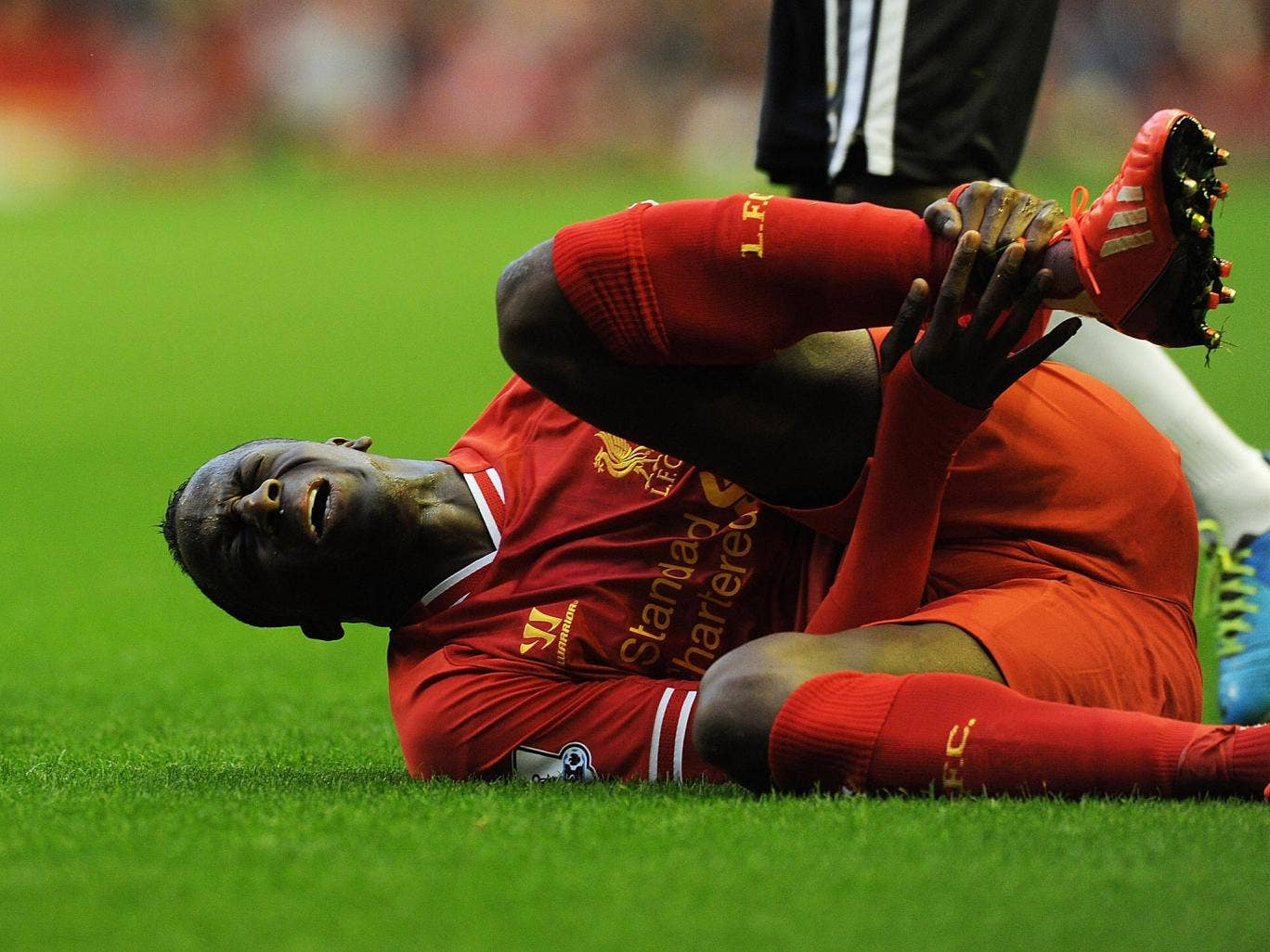 Aly Cissokho goes down injured in the Capital One Cup