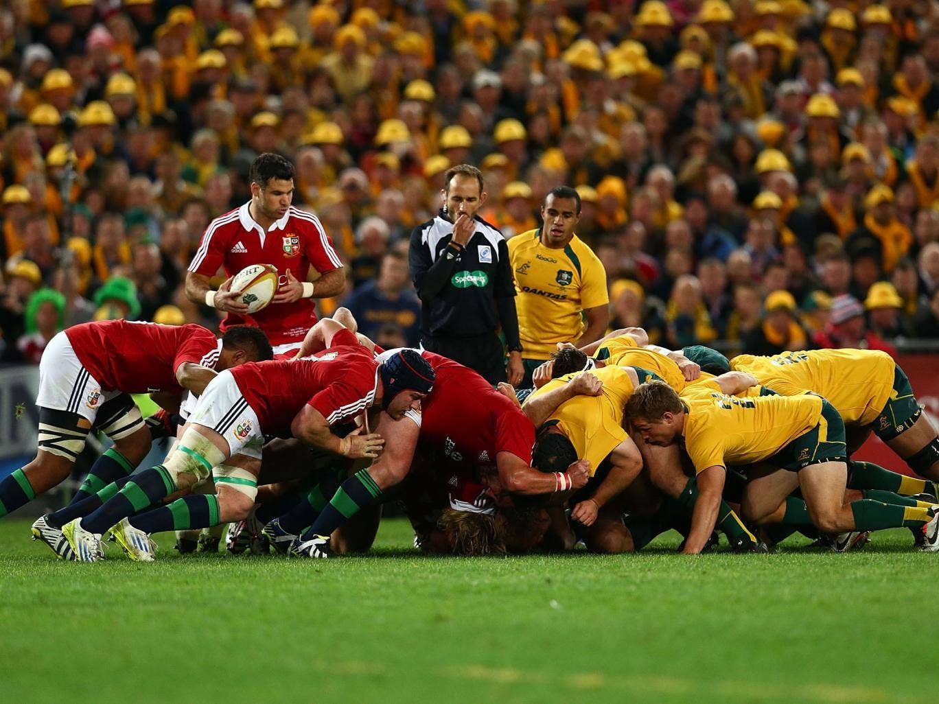 The referee blows as a scrum collapses during the Lions tour to Australia in June
